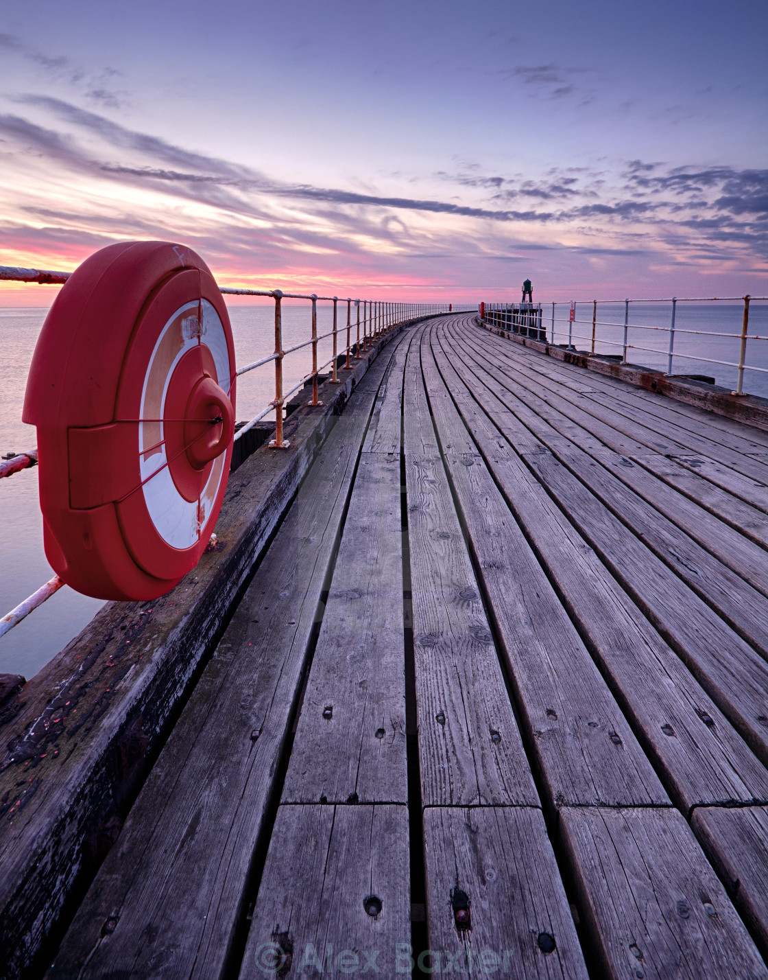 """Whitby Pier at Sunset"" stock image"
