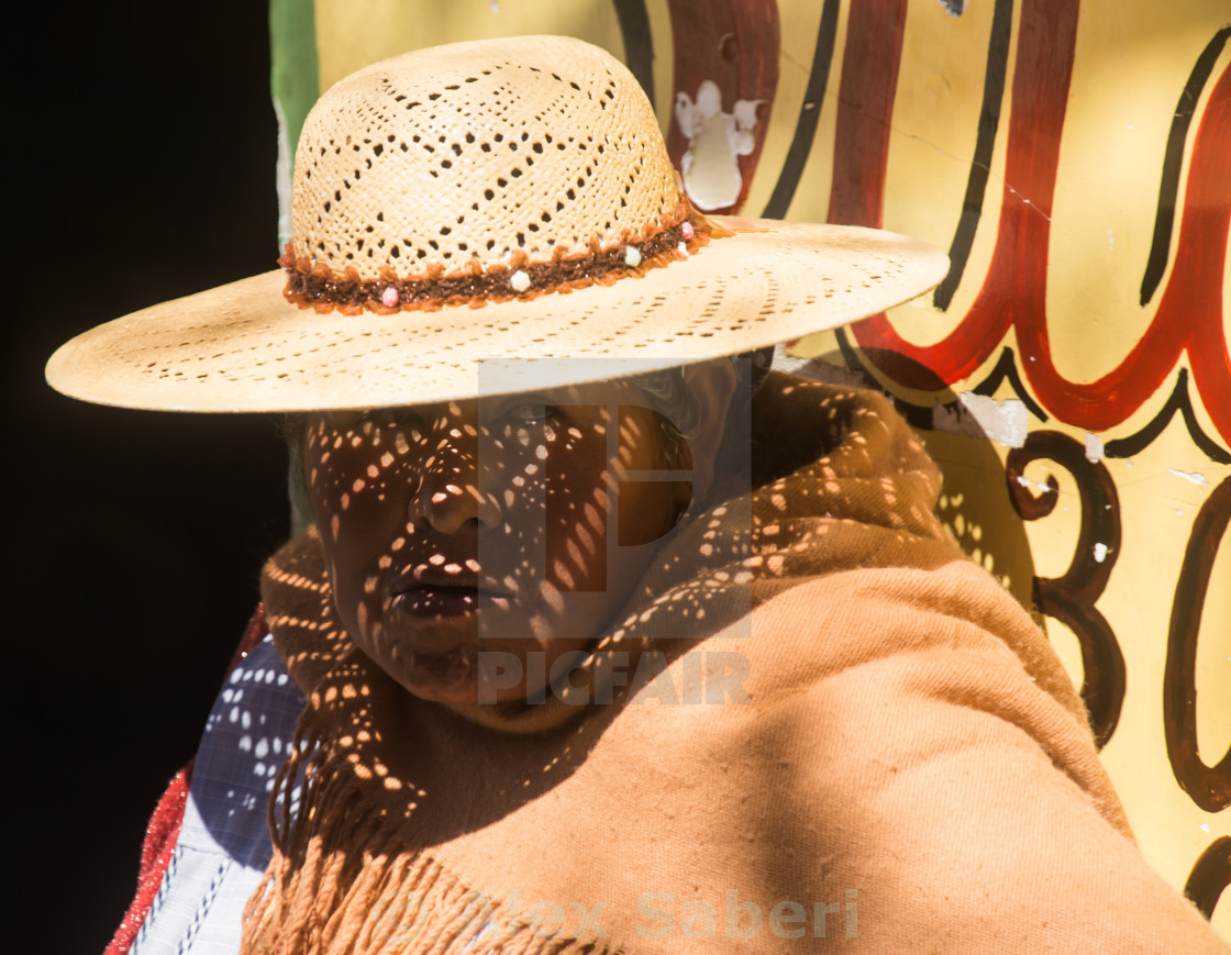 """""""A traditional Aymara woman with hat wait by the roadside in Uyuni town in Bolivia."""" stock image"""