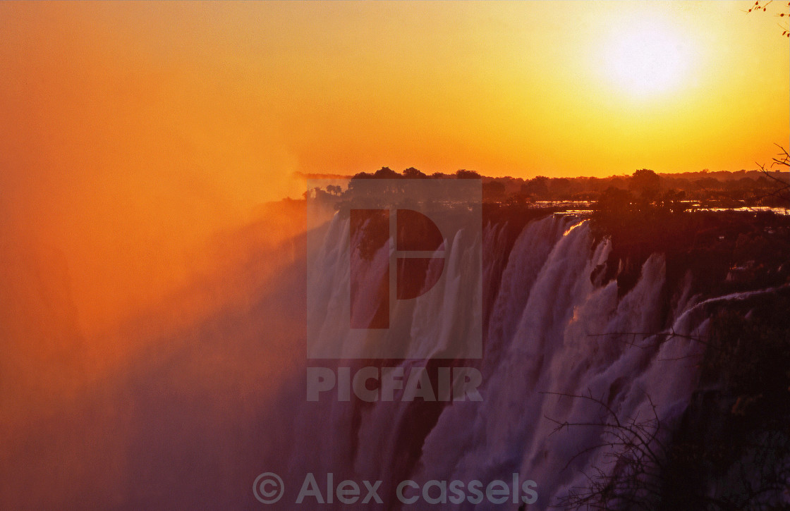 """Sunset over the Victoria Falls"" stock image"