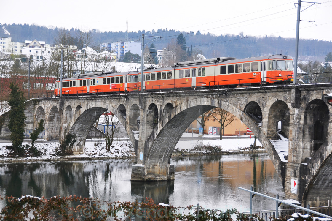 """Train crossing ancient bridge"" stock image"