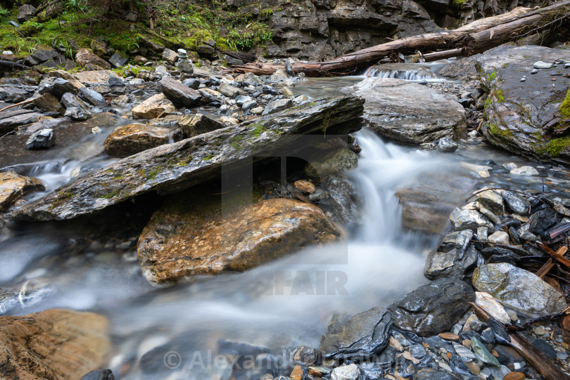 """""""Bodies of water, small creek with rocks"""" stock image"""