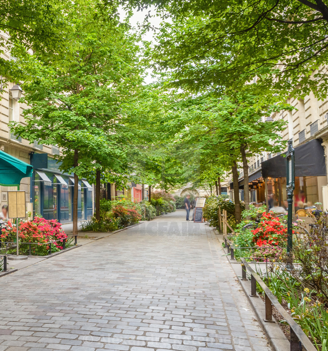 A Quiet Street With Restaurants In The Bohemian Marais