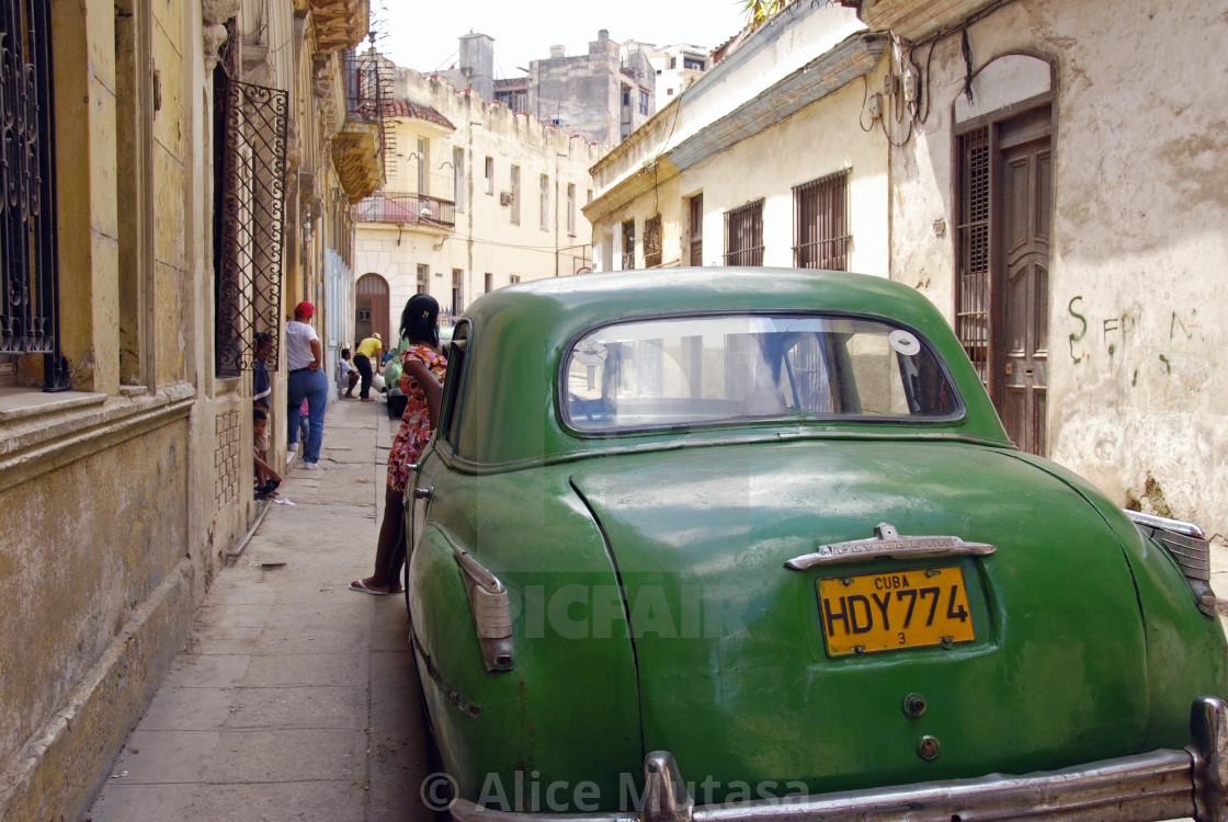 """Girl & green car; Havana, Cuba"" stock image"