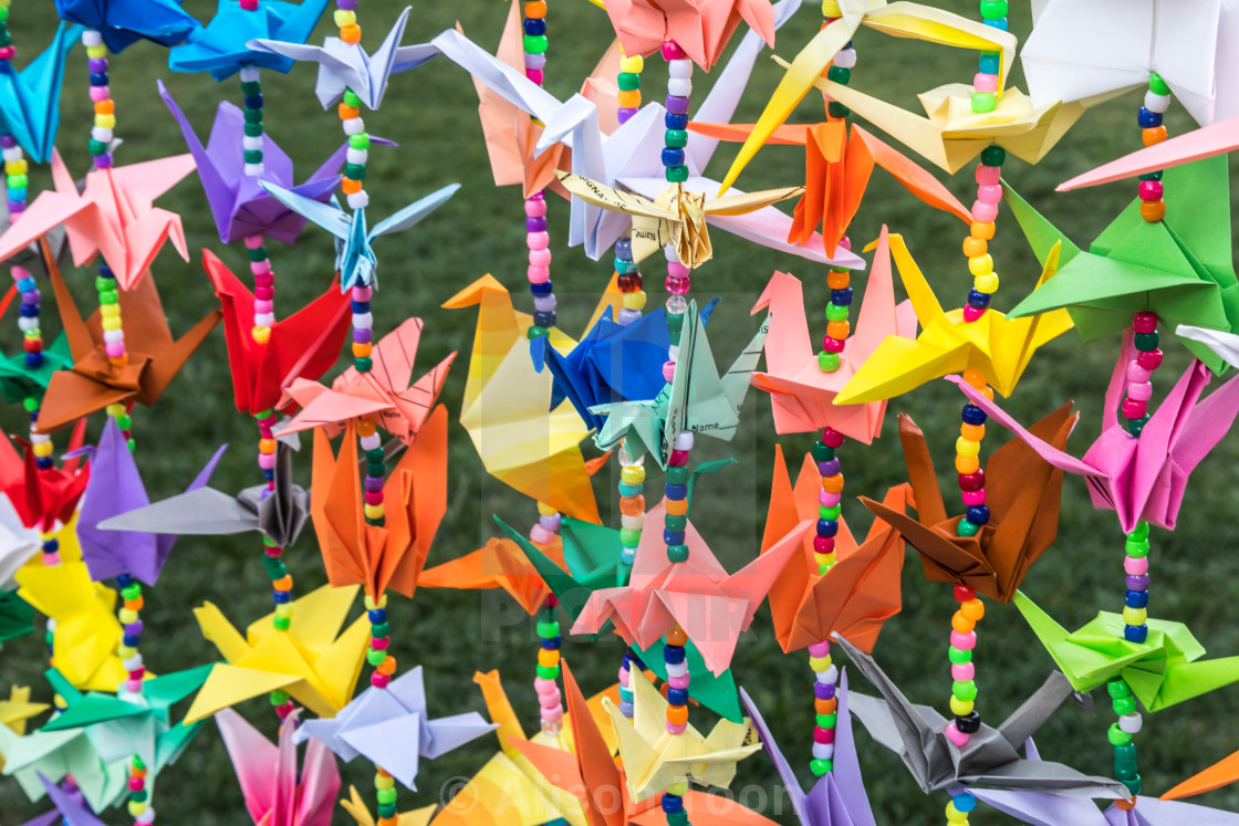 """Colorful garlands of Japanese origami cranes"" stock image"