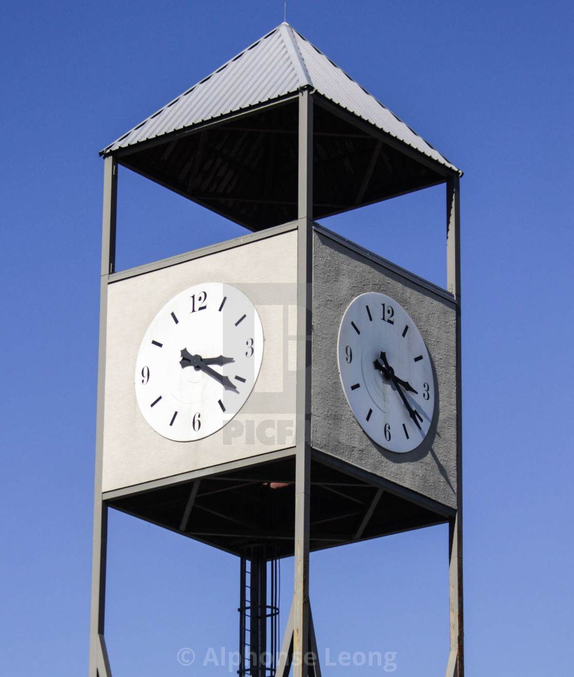 """Clock tower on a sunny afternoon"" stock image"