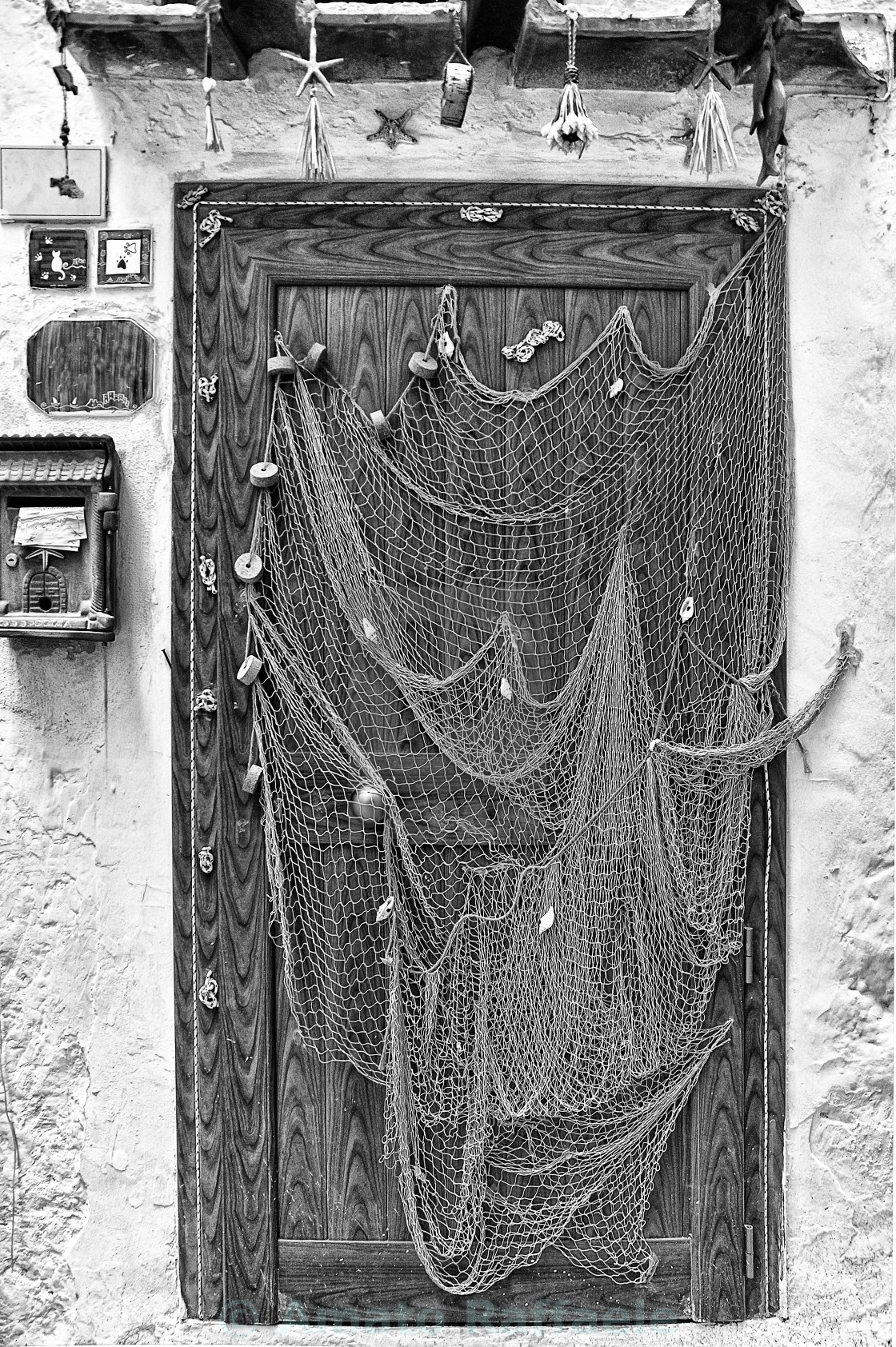 """fishing net used as decoration door of a house Sperlonga"" stock image"