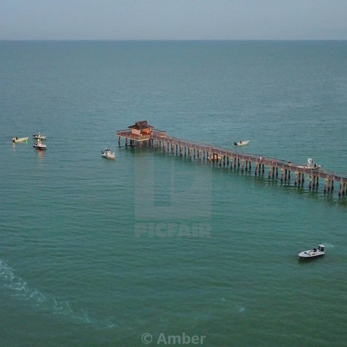 """""""Naples pier with drones"""" stock image"""