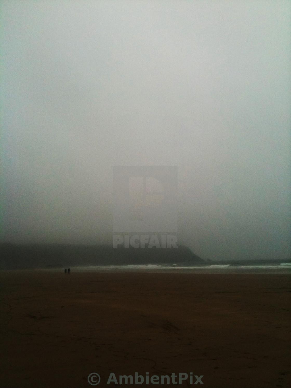 """Winter walk on beach"" stock image"