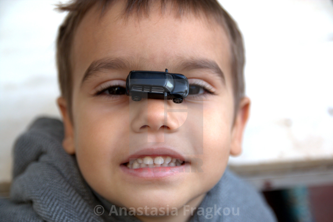 """""""Boy with a toy car"""" stock image"""