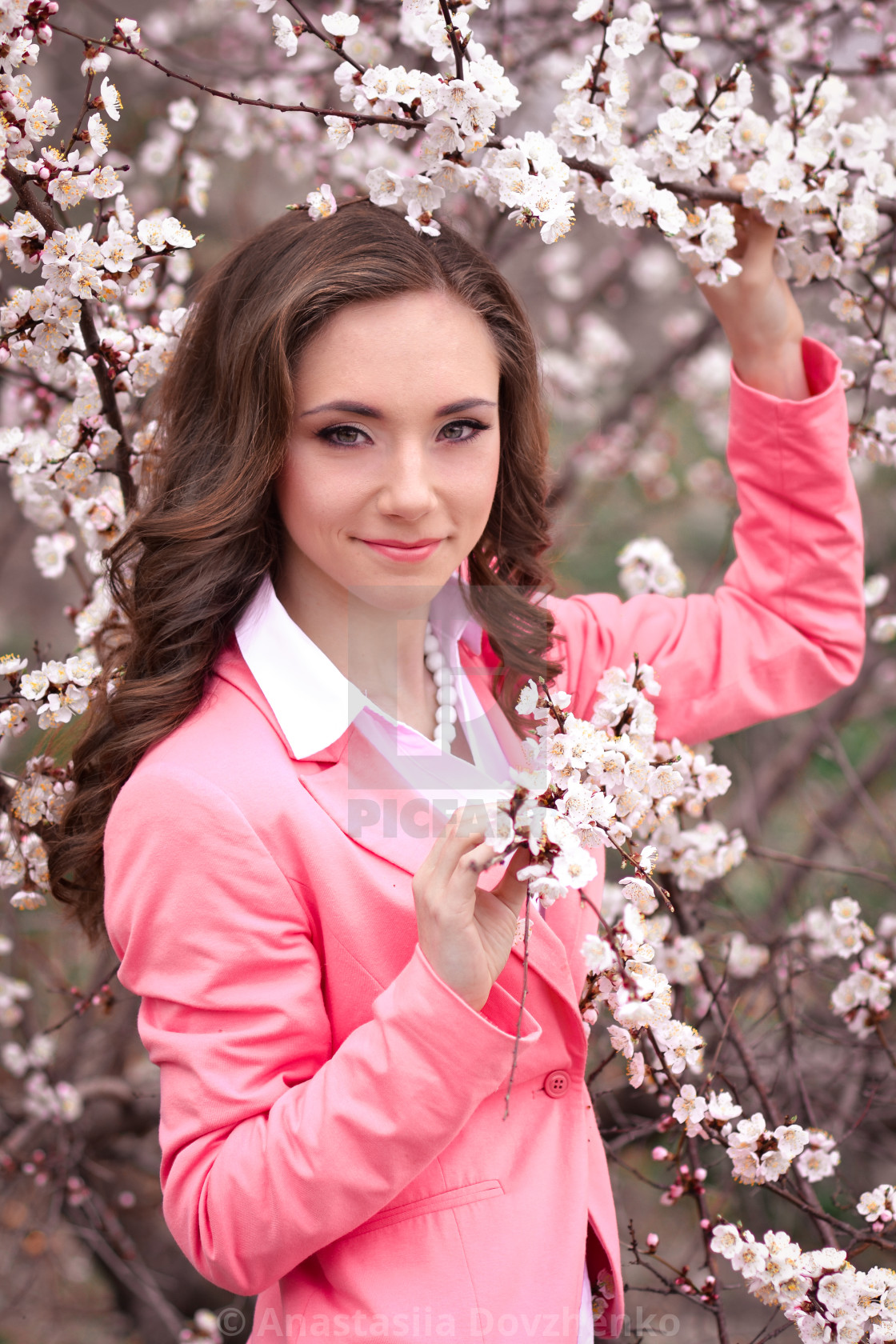 Very Beautiful Girl In Blossoming Trees In Spring Garden Spring