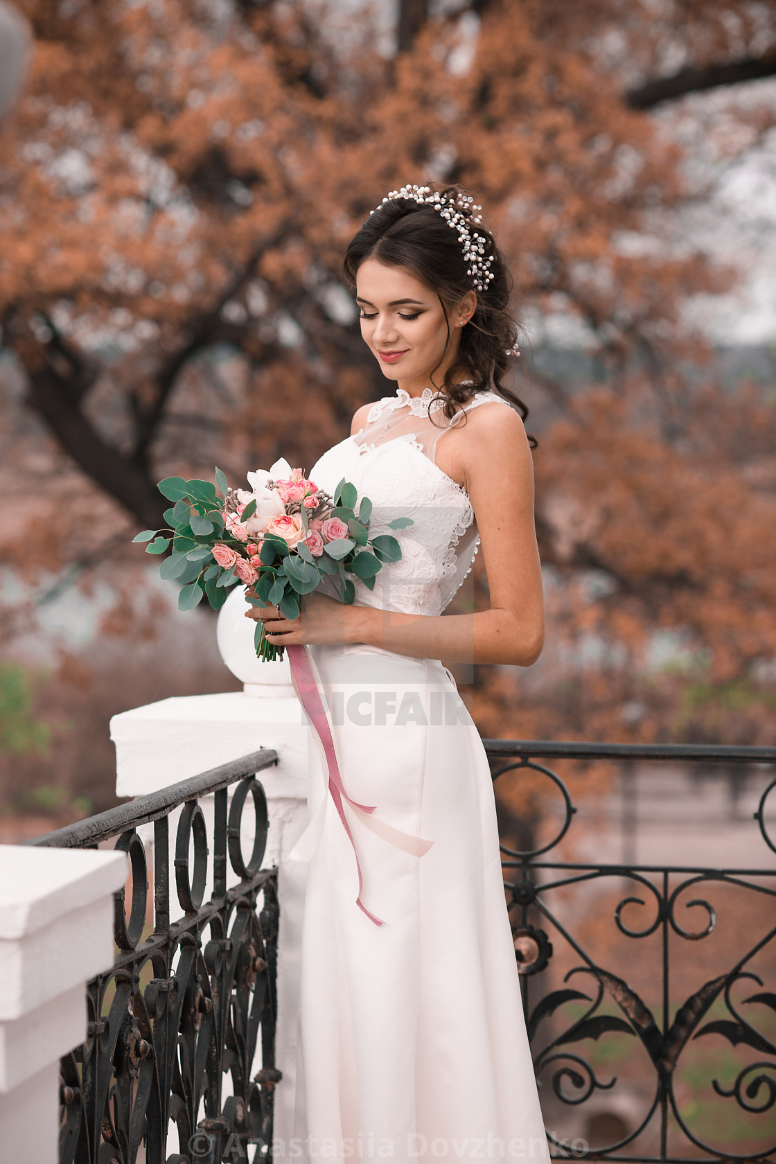 Beautiful Bride In Elegant White Dress Holding A Bouquet Of Flowers