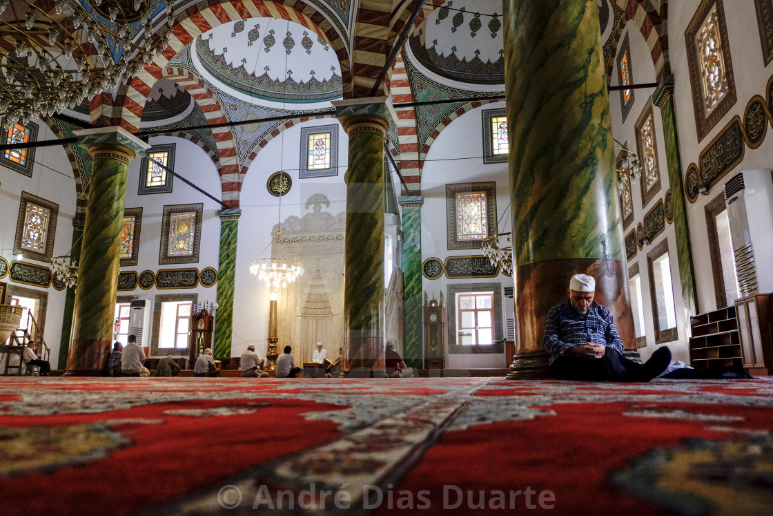 """Man sleeping in a mosque"" stock image"