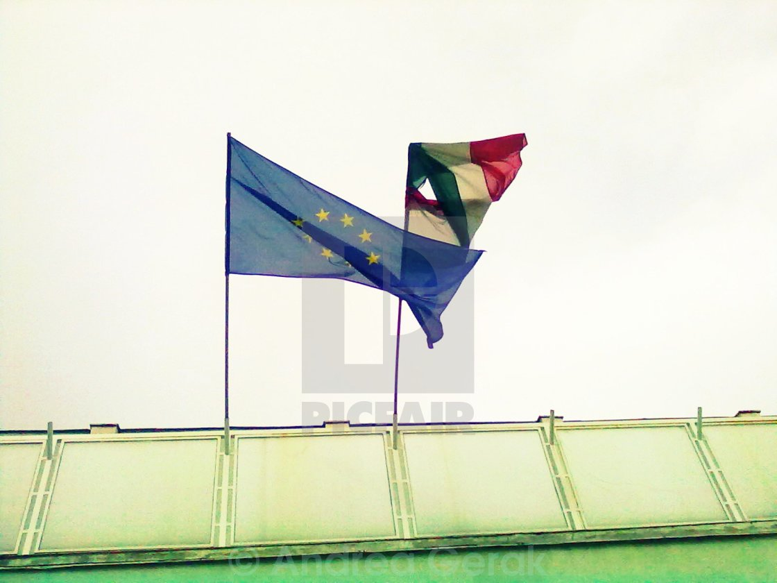EU and Hungary flags in stormy weather