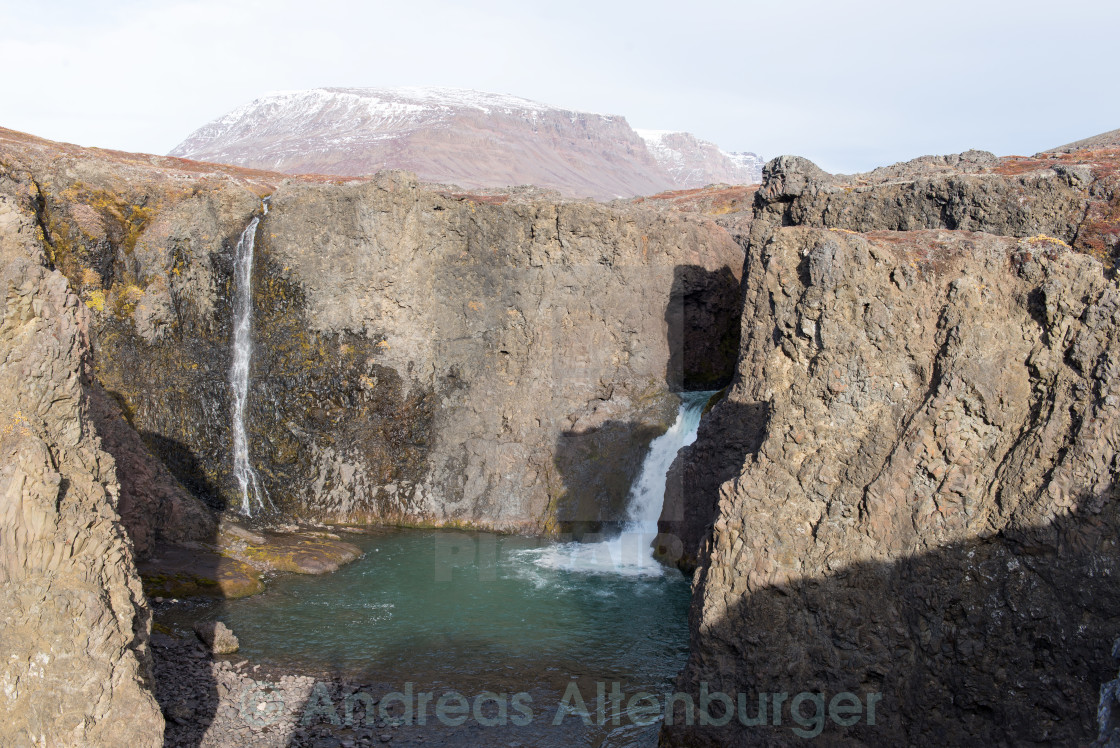 """Waterfall and landscape in Greenland"" stock image"