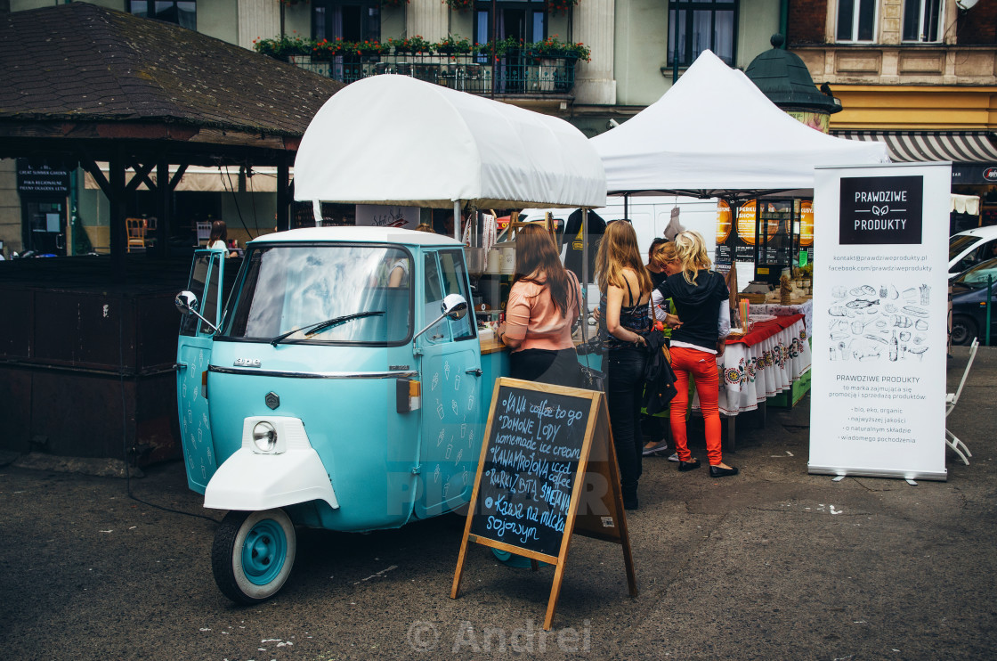 """Small vintage wagon with coffee and fast food, Krakow"" stock image"