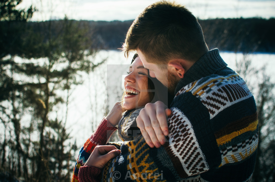 """Happiness couple embraces. Young man hugs a girl."" stock image"
