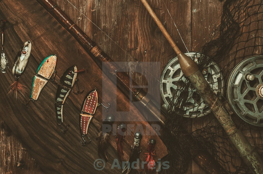 """""""Fishing tools on a wooden background"""" stock image"""