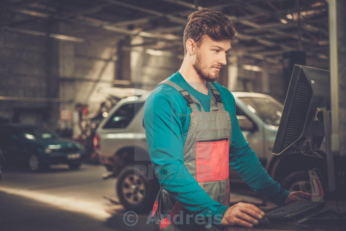 """Specialist near car diagnostic pc in a workshop"" stock image"