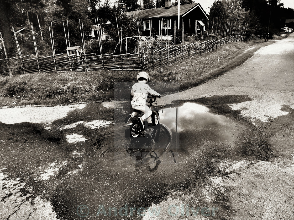 """Puddle Rider"" stock image"