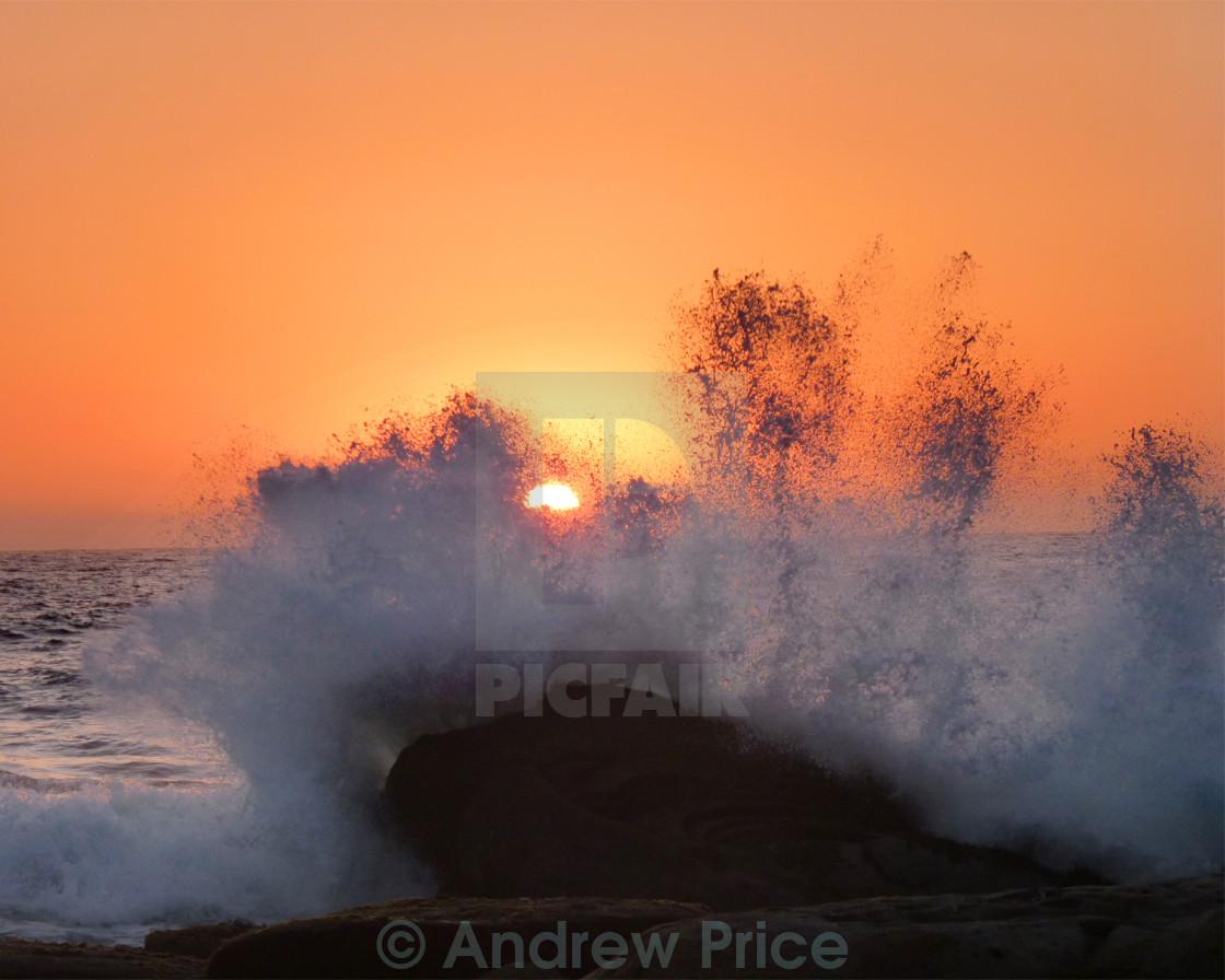 """Crashing at sunset"" stock image"