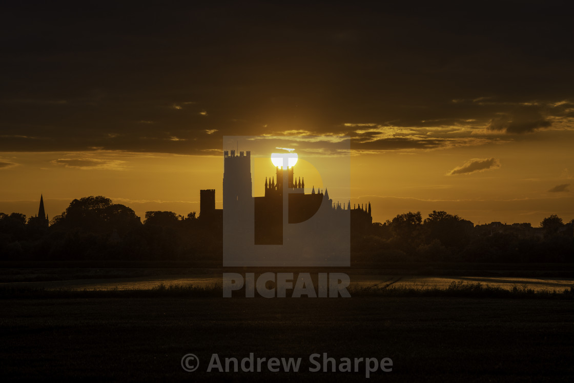 """Sunset behind Ely Cathedral, 21st June 2019"" stock image"