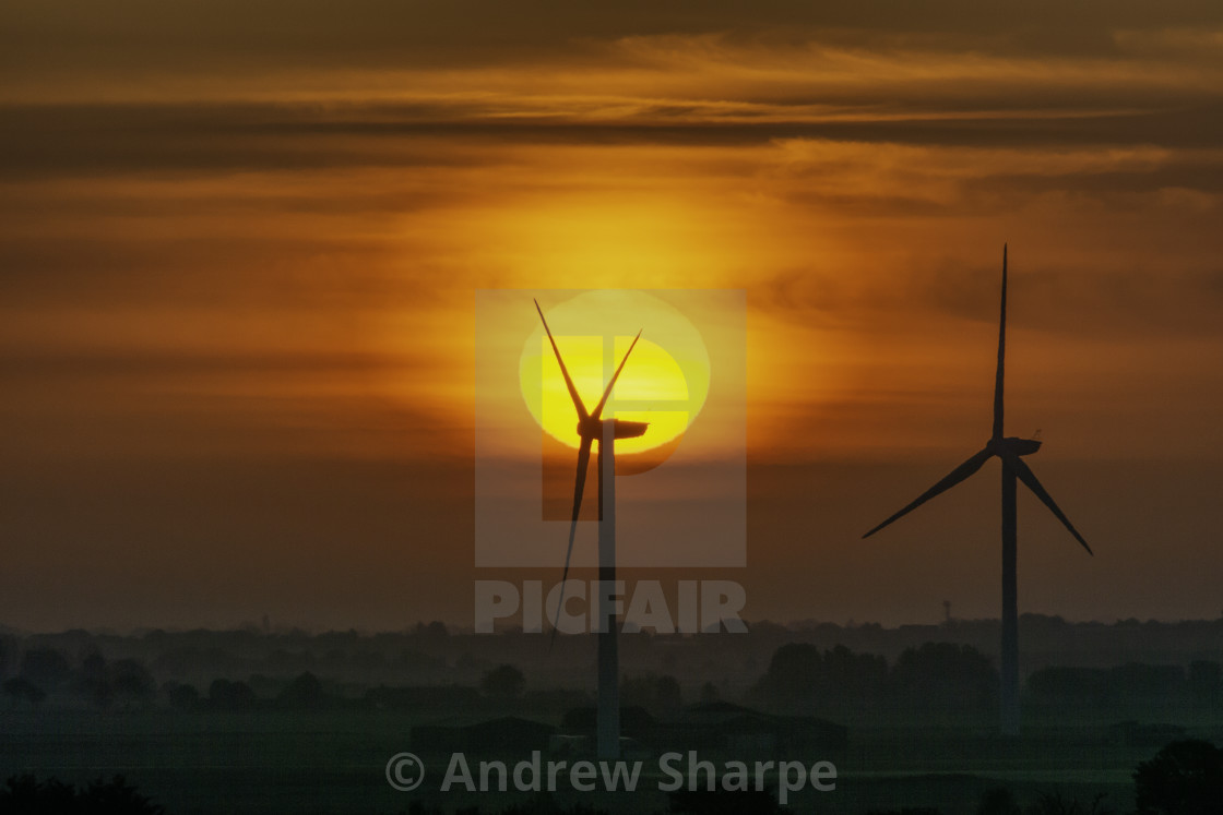 """Dawn over Tick Fen windfarm, from Warboys, 21st May 2019"" stock image"