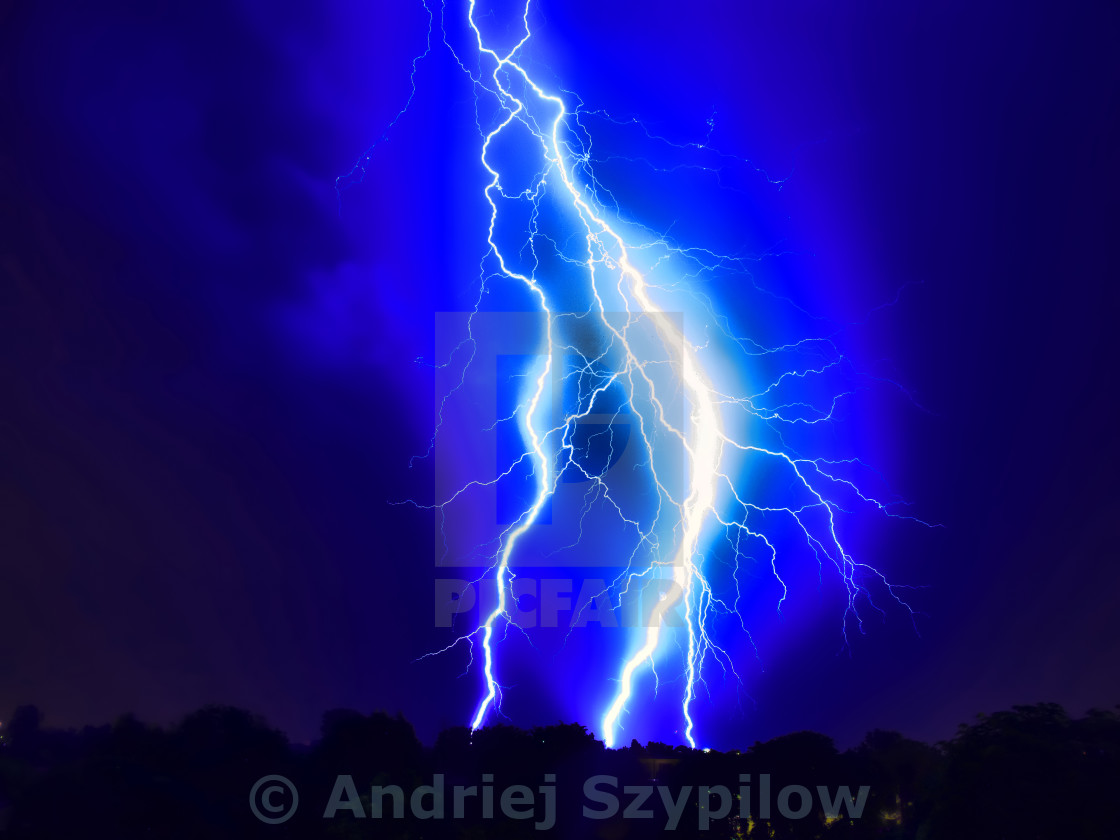 """Lightning strike on the dark cloudy sky"" stock image"