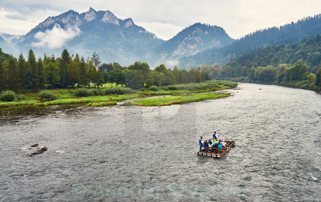 """""""Beautiful panoramic view of the Dunajec river with rafting rafts and Pieniny National Park, Poland, in rainy foggy september day"""" stock image"""