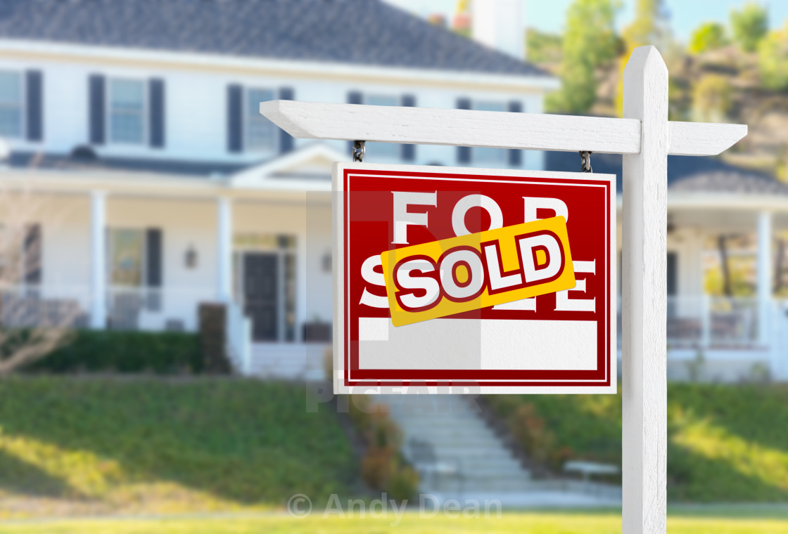 """""""Left Facing Sold For Sale Real Estate Sign In Front of House."""" stock image"""