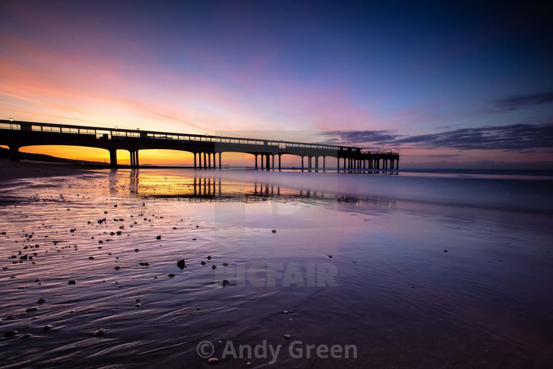 """Pier during sunrise"" stock image"