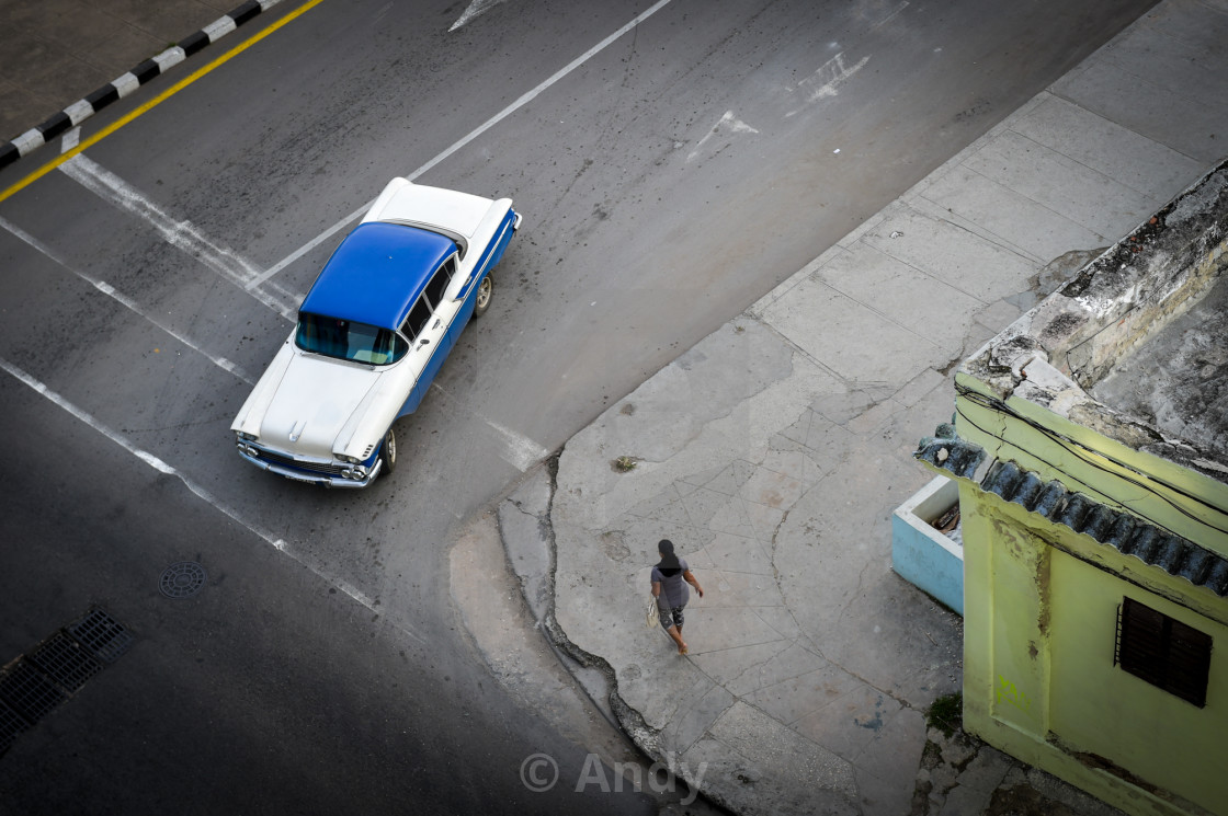 """A classic American car turns into a street in Old Havana"" stock image"