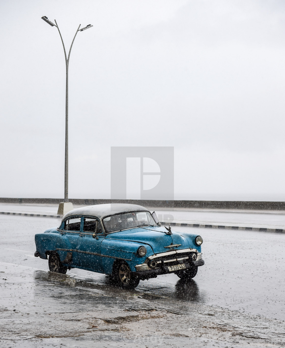 """American Car in the Rain, Havana, Cuba"" stock image"