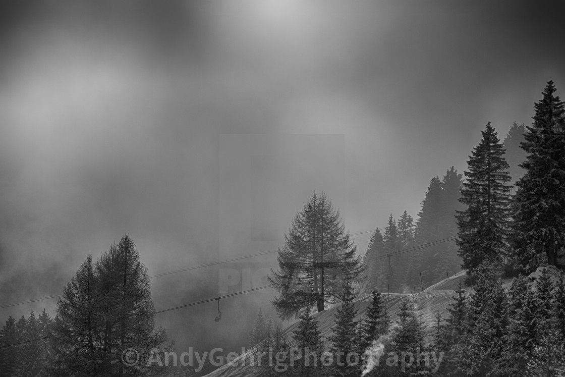 """Chairlift in the Fog"" stock image"