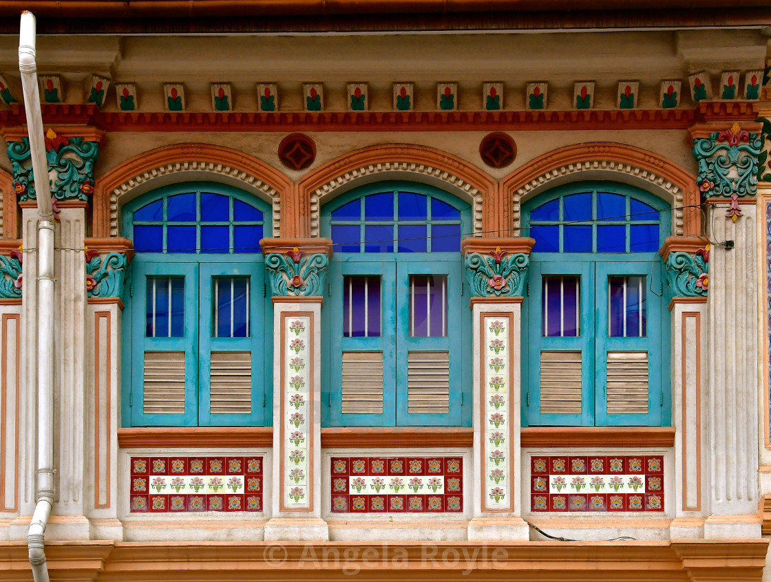 """Restored Peranakan shop house with turquoise wooden shutters."" stock image"