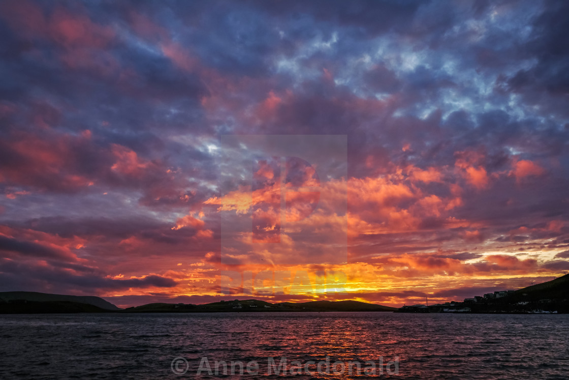 """Fiery Sunset, Shetland."" stock image"