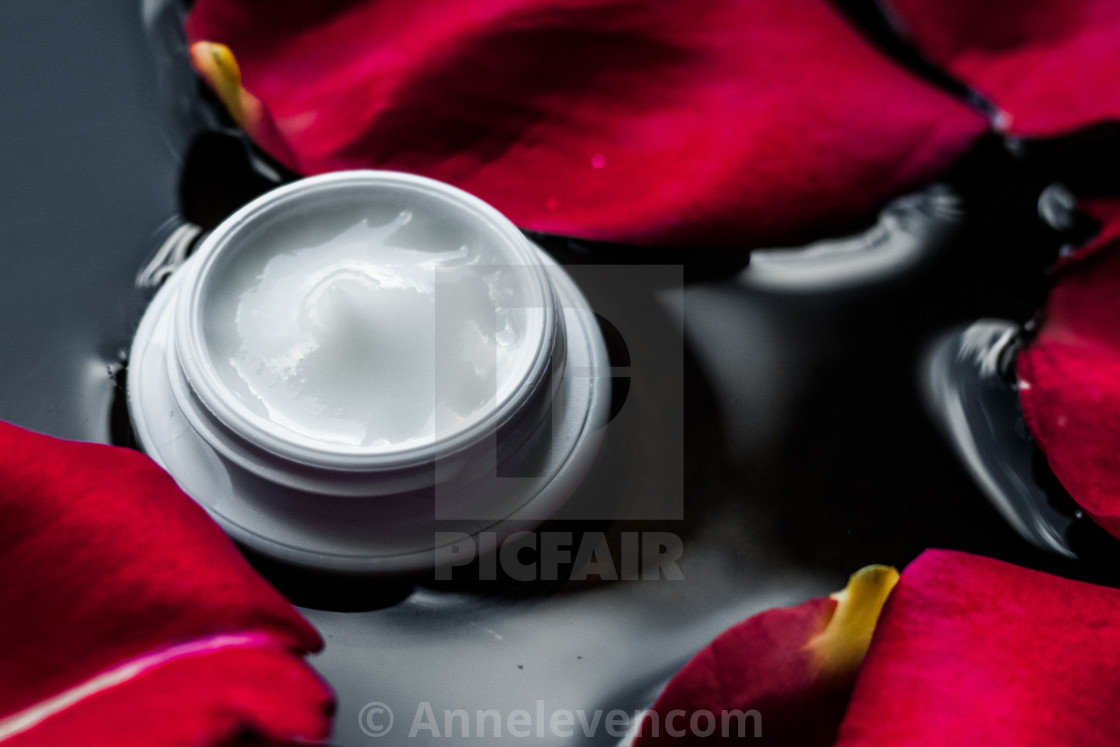 beauty cream jar and flower petals - cosmetics with flowers styled concept