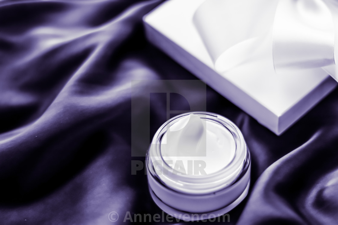 """""""Luxury moisturizing face cream with lavender scent on violet silk, skincare..."""" stock image"""