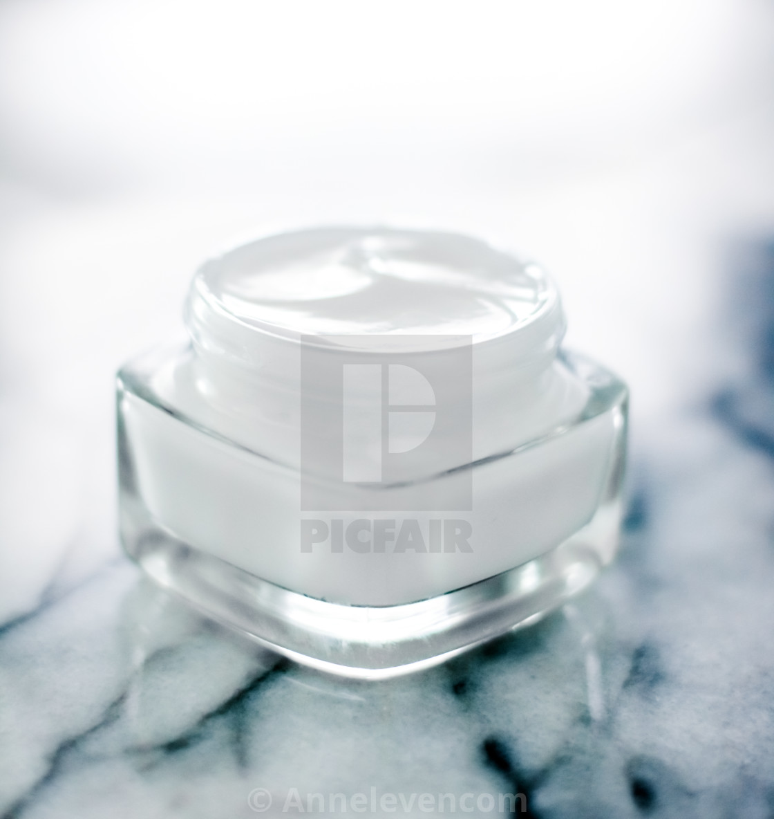 """Moisturizing beauty face cream on blue marble stone, skincare and spa cosmetics"" stock image"