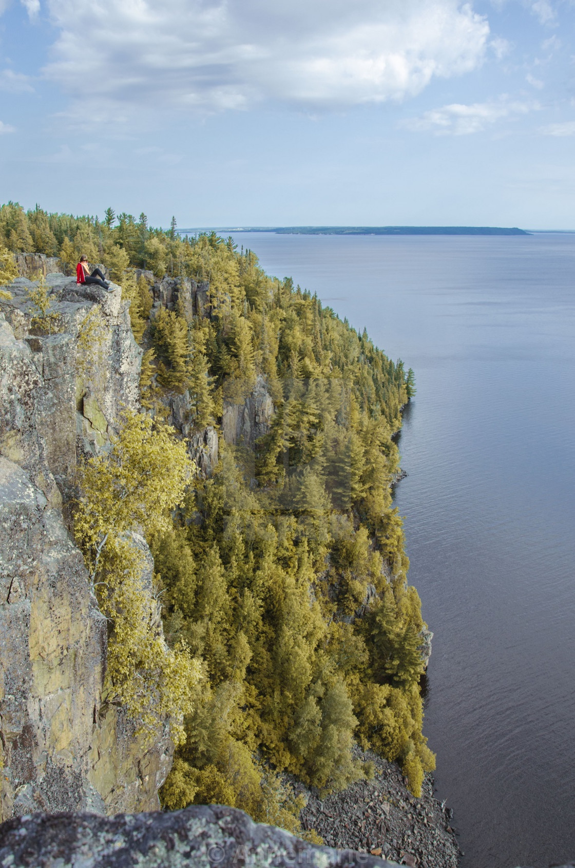 """Steep autumn cliff with lakeview"" stock image"