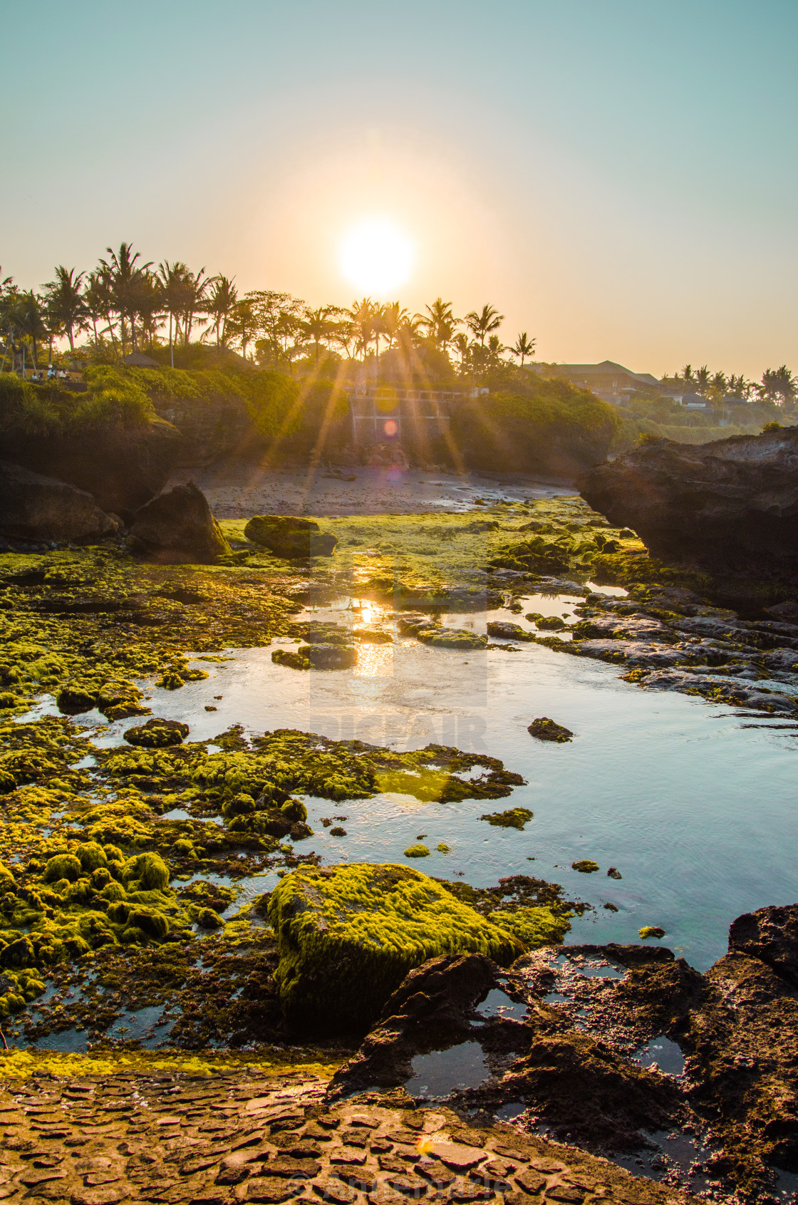 """Sunrise over black beach in Bali"" stock image"