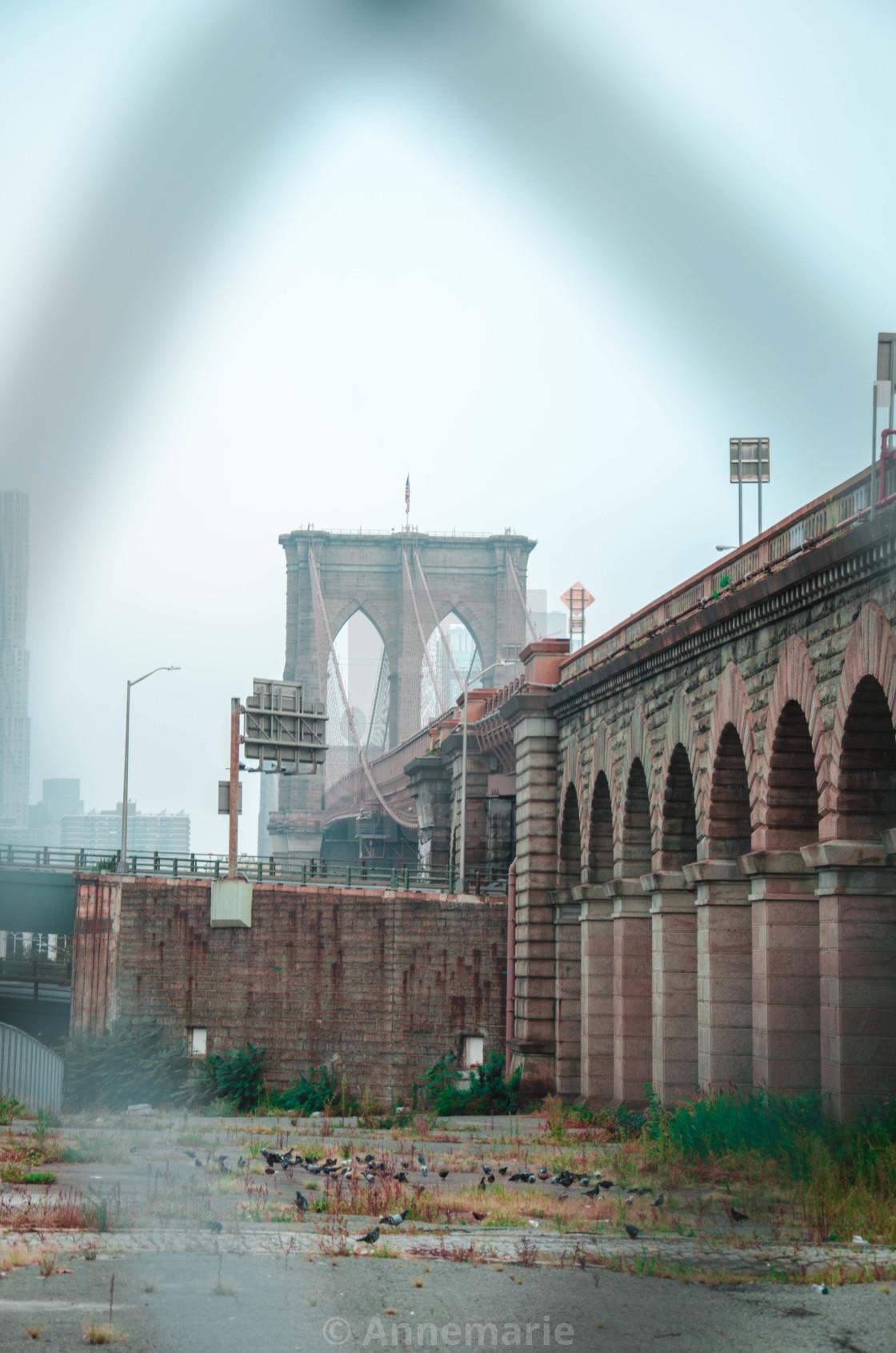 """Brooklyn Bridge through a fence"" stock image"
