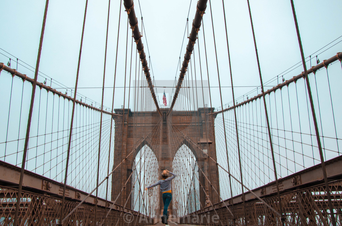 """Brooklyn Bridge with jumping woman"" stock image"