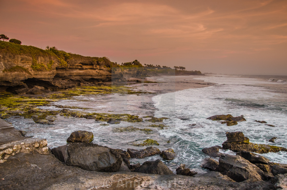 """Beach in Bali at orange sunset"" stock image"