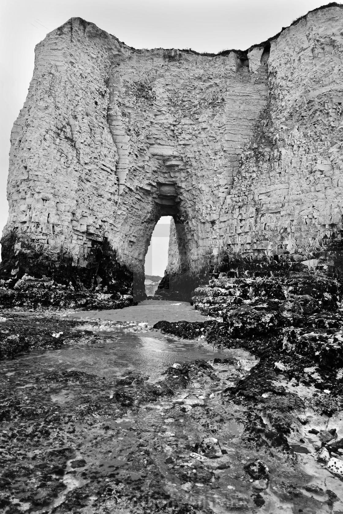"""Kingsgate Bay sea arch"" stock image"