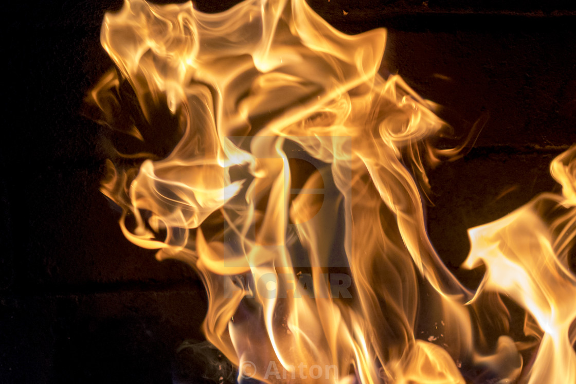 """Bright fire in the fireplace close-up. red-yellow fire background. The..."" stock image"