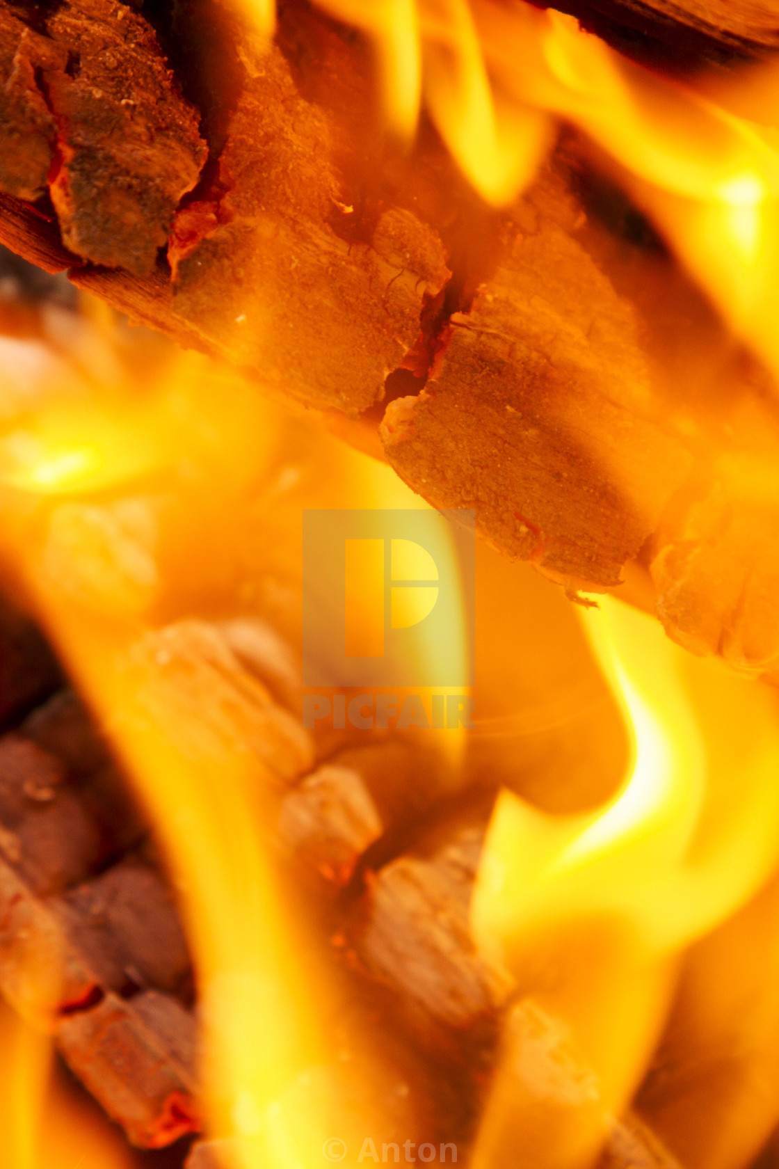 """Burning firewood close-up. Yellow-red background of fire and flame."" stock image"