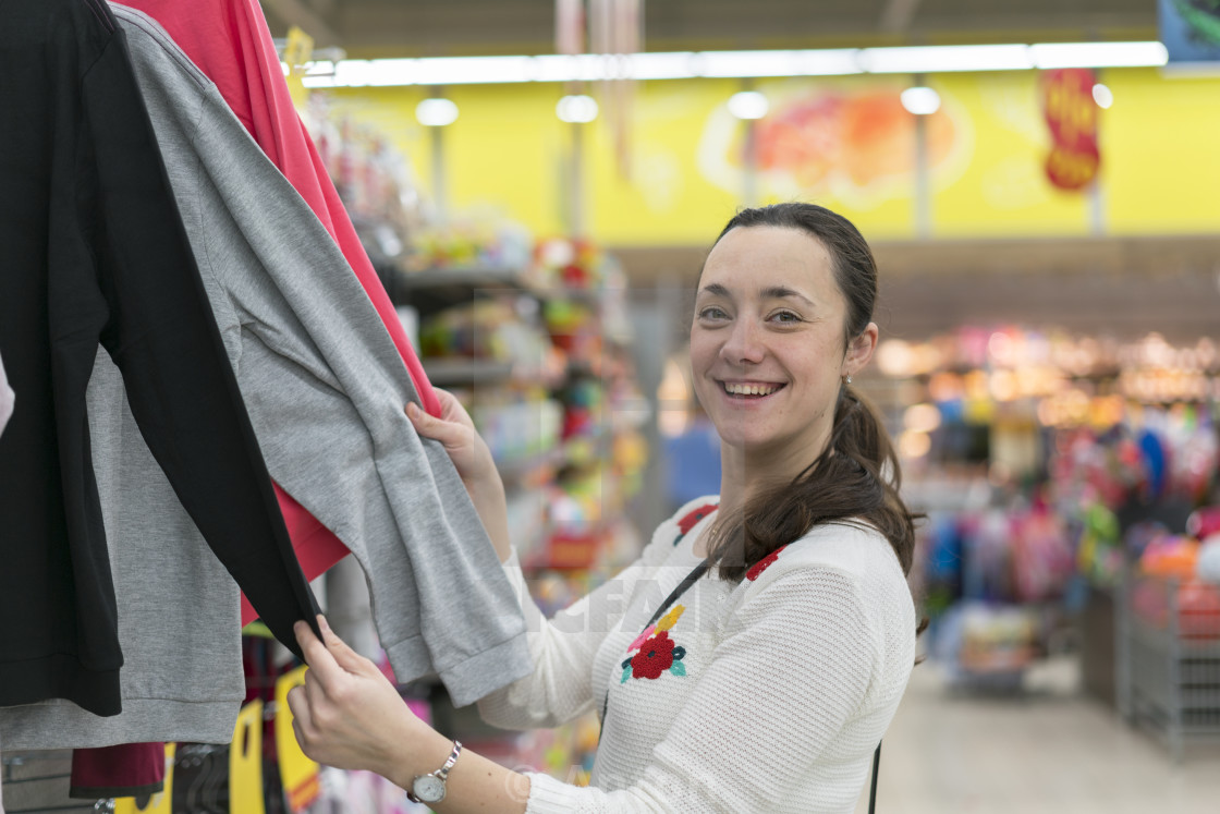 """""""pretty elegant woman shopping in clothes store"""" stock image"""