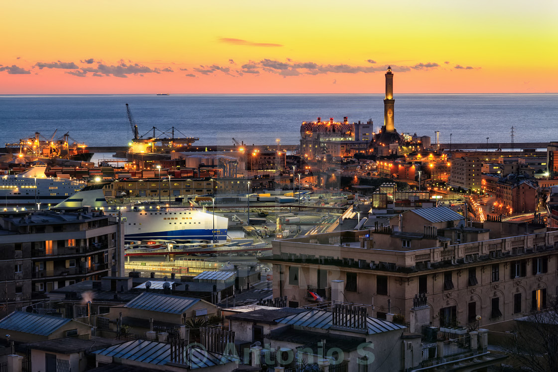 """view of Genoa harbor at sunset"" stock image"