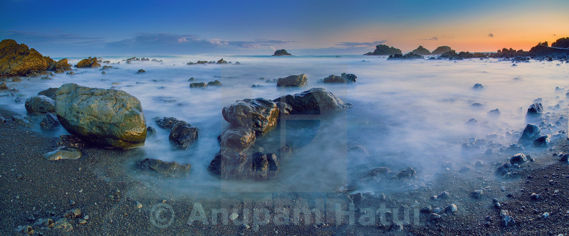 """Dusk colors at Cape Palliser New Zealand"" stock image"