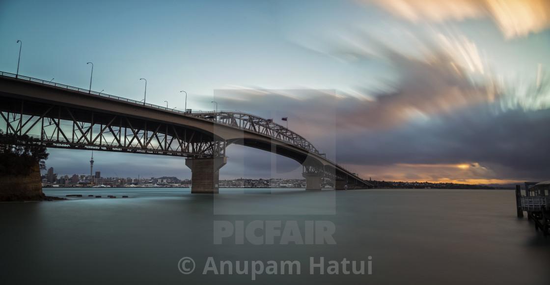 """Auckland Harbor Bridge at dusk"" stock image"